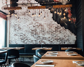 Cropped image of a brick wall and chic tungsten light fixtures in the restaurant in Richmond B.C.