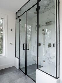 Cropped image of a custom matte black bathroom.