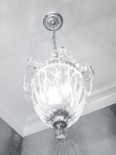 A hanging bathroom, glass light fixture.