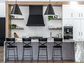 Cropped image of a renovated, contemporary white Langley home with black light fixtures.