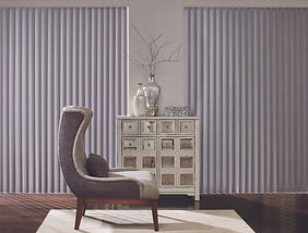 Cadence vertical blinds, a chair, and a cabinet drawer.
