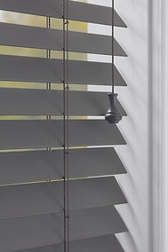 Wood and metal blinds.