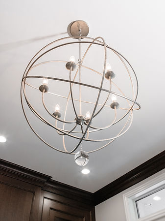 Gold, spherical light fixture.