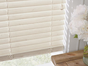 Everwood blinds and white flowers.