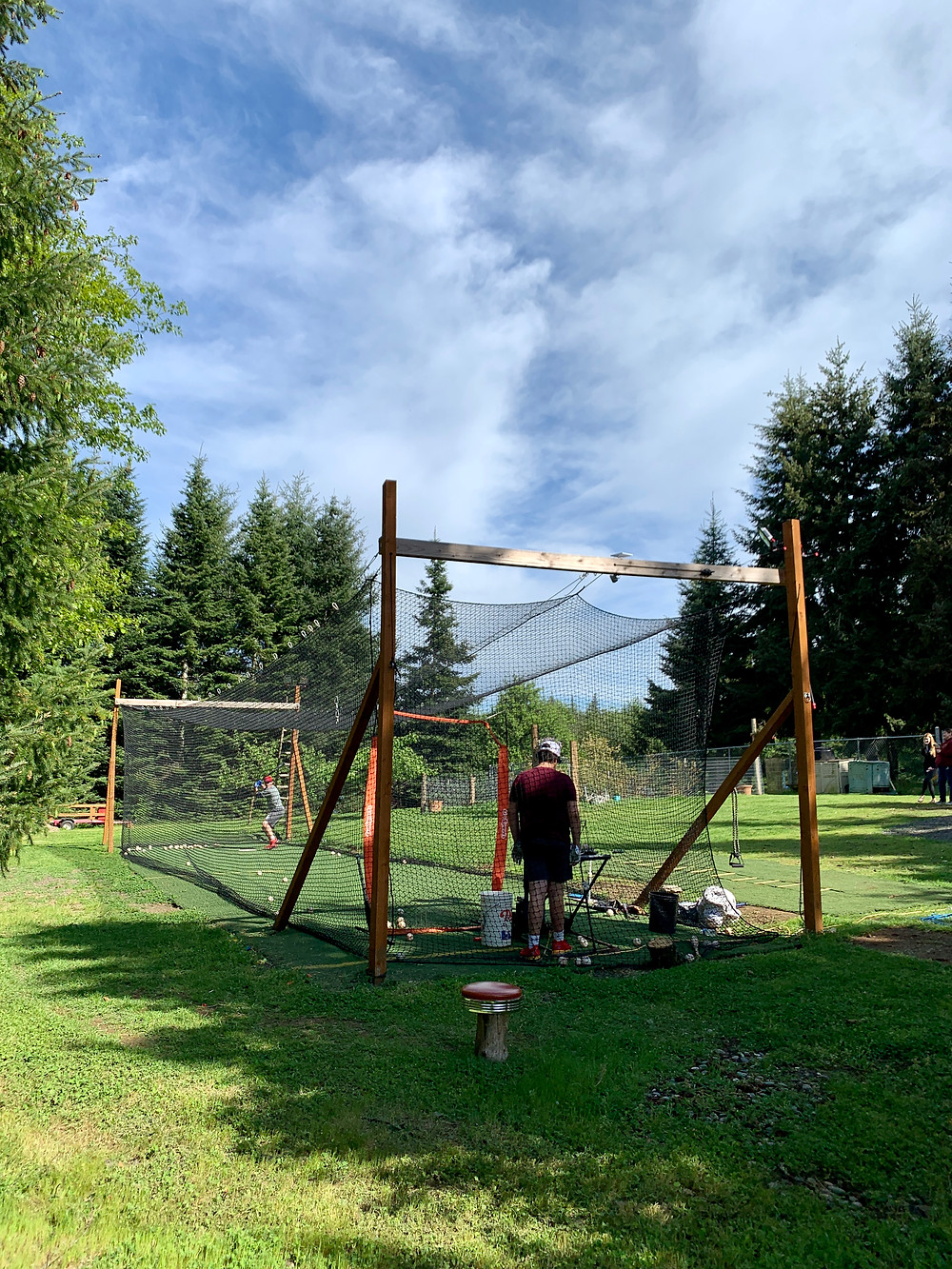 Batting cage finished product on a summer night.