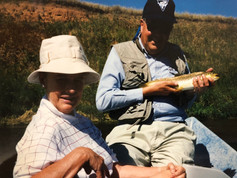 Aase and Christian trout fishing  at his dear friend JD Guffey's fishing lodge in Wyoming in 2004