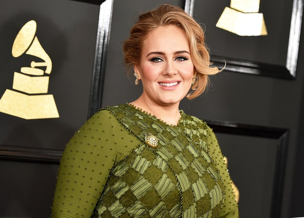 We were in love with Adele's makeup and color of her dress at the Grammy's