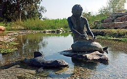 Salado creek; fisherman statue.