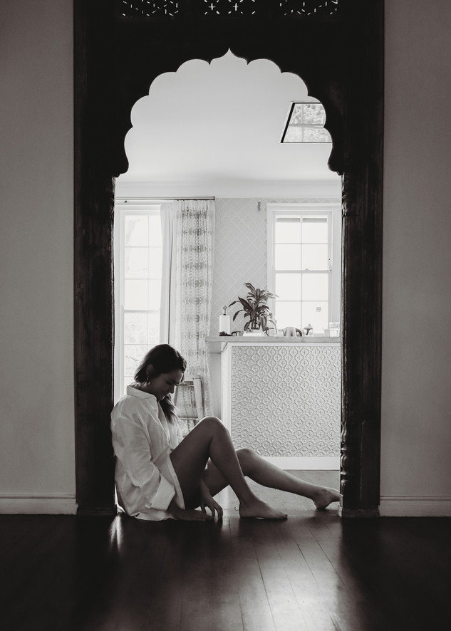 """<img src=""""women in mens shirt photo.jpg"""" alt=""""Women in mens shirt sitting in the archway of a beautiful doorway in black and white"""">"""