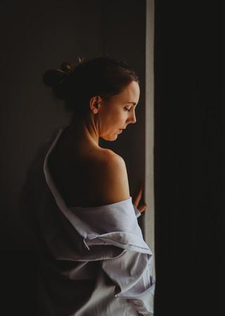 "<img src=""female photo.jpg"" alt=""women wearing mens shirt looking out of the window"">"