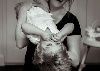 "<img src=""maternity photo.jpg"" alt=""Maternity photoshoot motherhood mother holding son upside down"">"