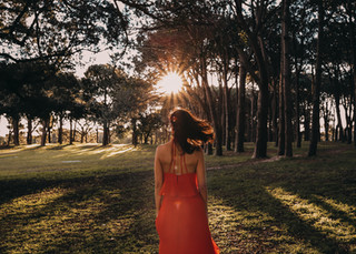 """<img src=""""red dress in the woods photo.jpg"""" alt=""""Women in red dress standing in the middle of the woods surrounded by trees sun flare"""">"""
