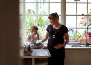 """<img src=""""maternity photo.jpg"""" alt=""""Maternity photoshoot motherhood pregnant mother with son in the kitchen"""">"""