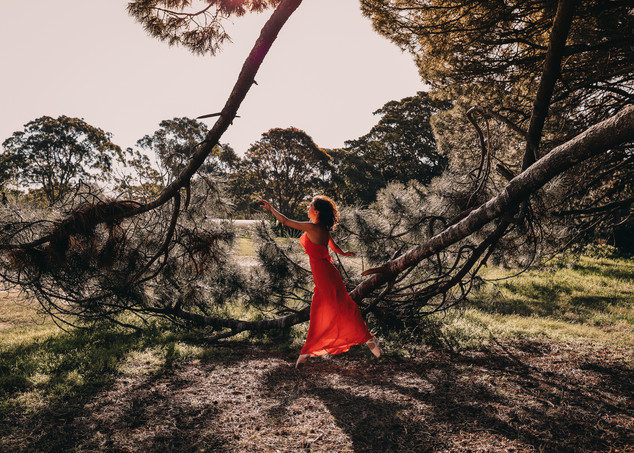 """<img src=""""red dress in the woods photo.jpg"""" alt=""""Women in red dress dancing in the middle of the woods by a large branch"""">"""