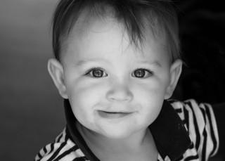 """<img src=""""family photo.jpg"""" alt=""""Smiling toddler boy in black and white"""">"""