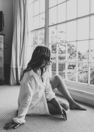 """<img src=""""women in mens shirt photo.jpg"""" alt=""""Women in mens shirt sitting by a large window in black and white"""">"""