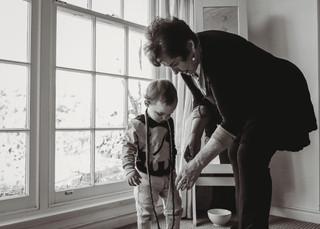 "<img src=""family photo.jpg"" alt=""Family photoshoot Grandma and Grandson infront of a window"">"