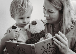 """<img src=""""family photo.jpg"""" alt=""""Family photoshoot Mother reading a book to her son motherhood"""">"""