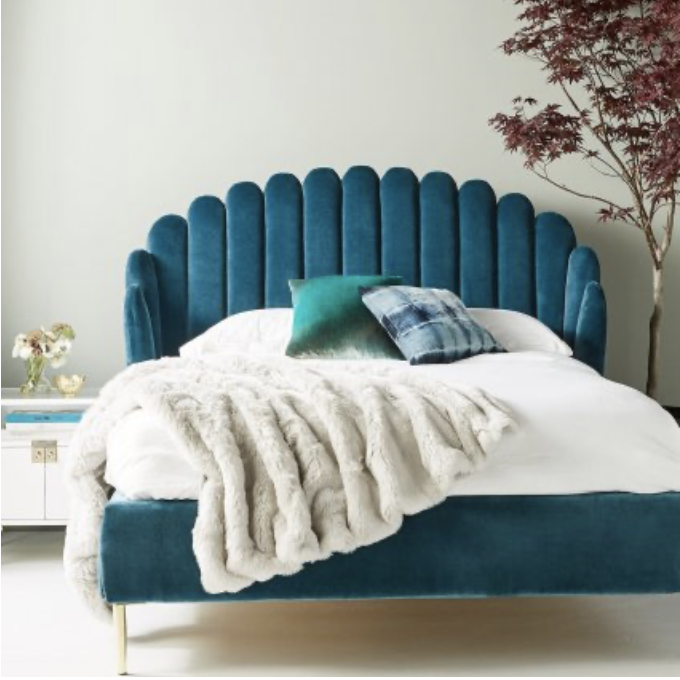 Teal Green Bed with Cushions and Sheepskin