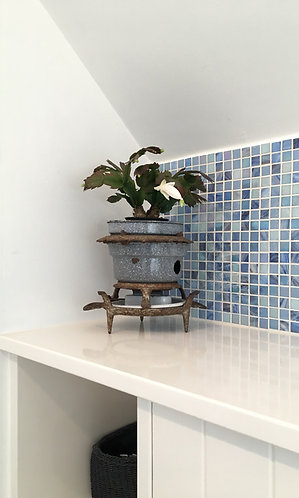 Kerosine Stove in Front of Blue Tiles