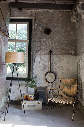 Woodland Tripod Floor Lamp in Living Room with Rattan Chair