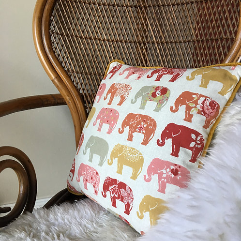 Close up of spice elephant cushion on peacock chair