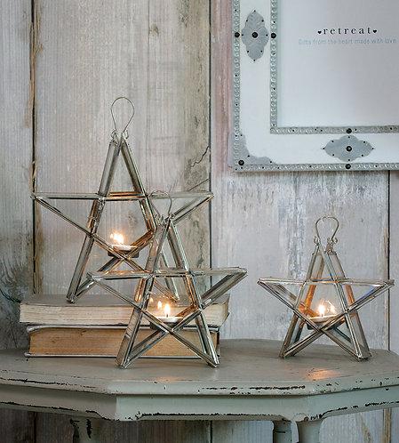 Three Star Shaped Lanterns on a Table