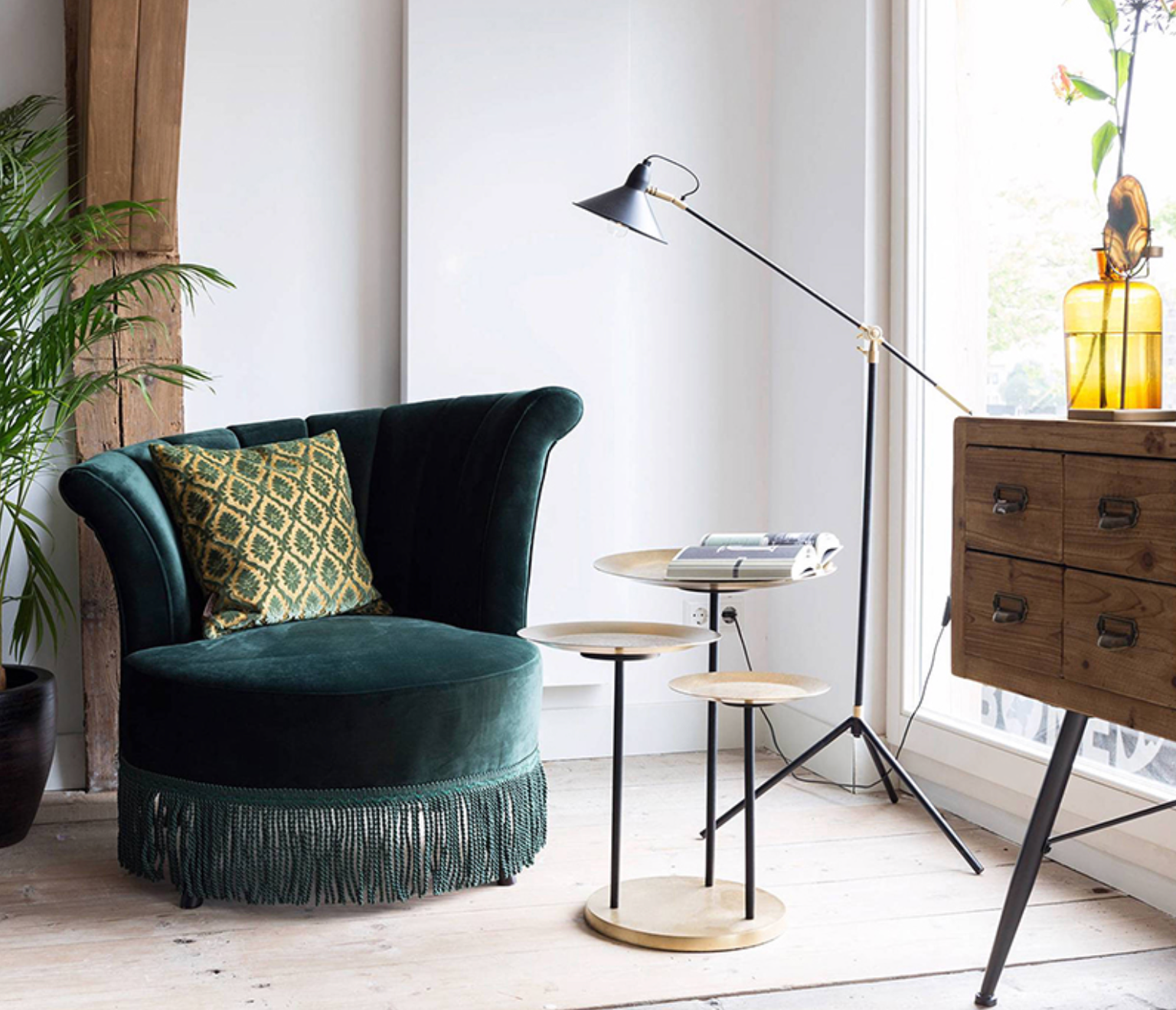 Green Chair with Nest of Brass Tables and Brown Cabinet