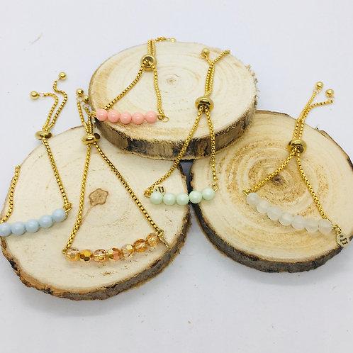 Bracelets réglables doré en acier inoxydable et perles diverses