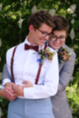 two cuddling lovers on their wedding day