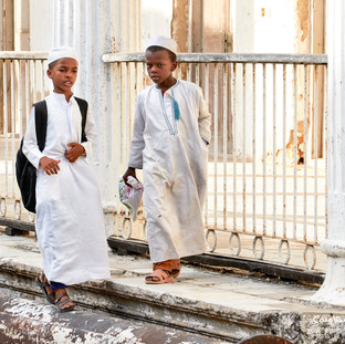 Young boys walking in Stonetown