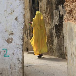 Lady walking in Stone Town
