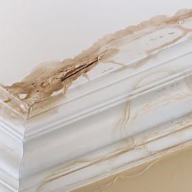 Peeling paint on an interior ceiling a r
