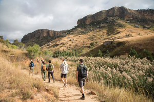 hikers walk through the Isalo sand stone in Madagascar