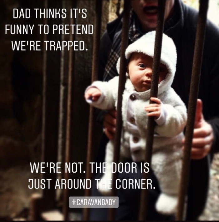 """Baby behind bars held by father says """"Dad think it's funny to pretend we're trapped. We're not. The door is just around the corner"""". The lack of space living and traveling in a caravan isn't the issue."""