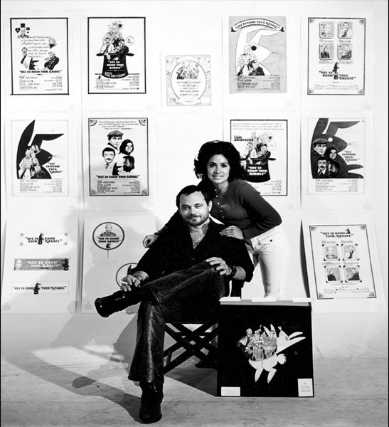 Lollie and Don in front of their movie ad campaigns