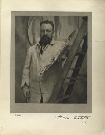 portrait_of_henri_matisse_standing_at_his_easel