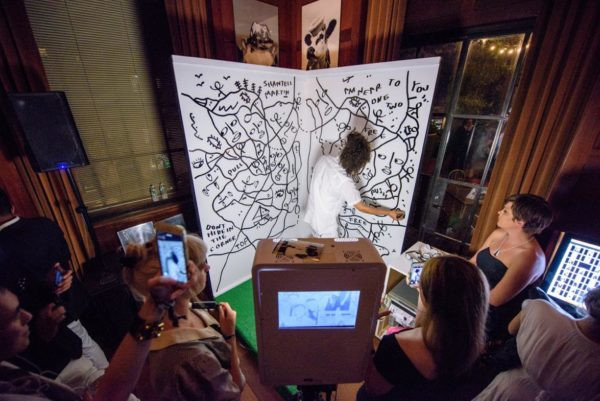 Shantell Martin at work in front of fans