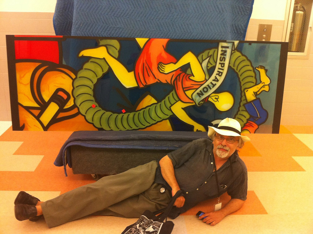 Art Spiegelman poses with one of his stained glass windows at the High School of Art and Design.