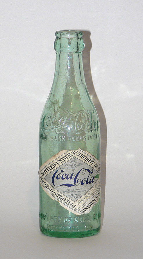 A Coca-Cola bottle that was used between 1900 and 1916. with label