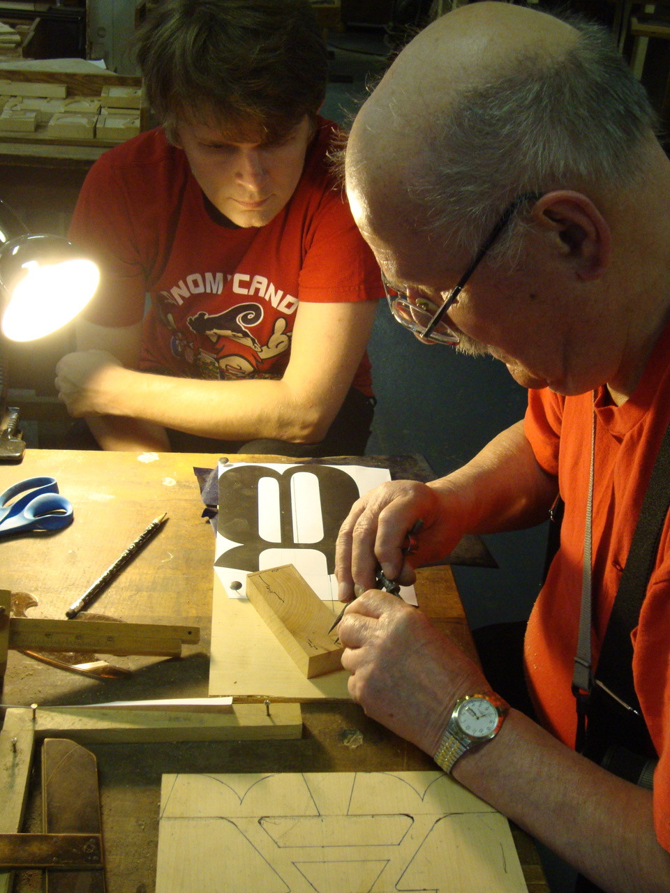 Designer Nick Sherman (left) conferring with Hamilton retiree Norbert Brylski at the original Hamilton factory in 2011.