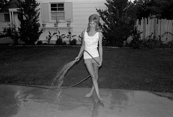 "John Divola: from ""Women Watering their Lawns"" series, 1971."