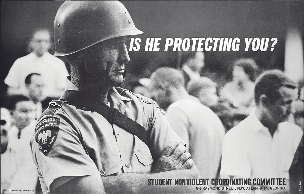 SNCC poster with photo of Mississippi policeman by Danny Lyon, 1962. Photograph used by permission from Danny Lyon/Magnum Photos.