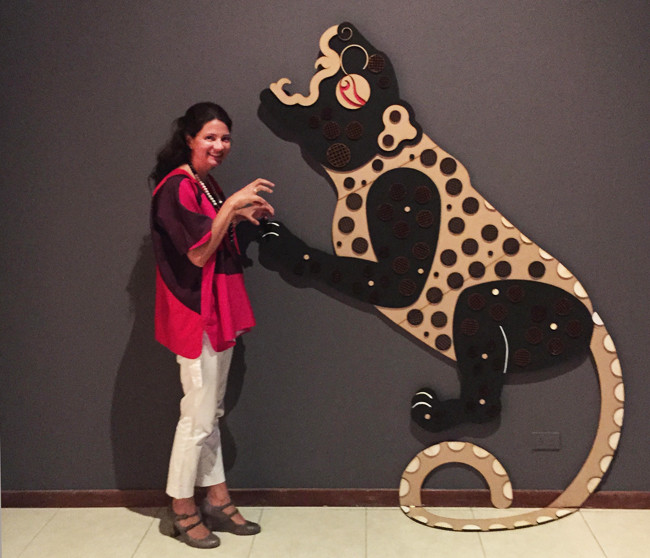 Frida Larios with a sculpture of her Jaguar at the opening of her exhibition in El Salvador in August 2015.