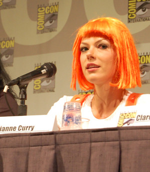 Adrianne Curry on a Comic-Con panel, discussing how liberating it is for women to wear sexy outfits. Later, she was officially escorted from the convention because of her barely-there Aeon Flux costume. Photo by M. Dooley.