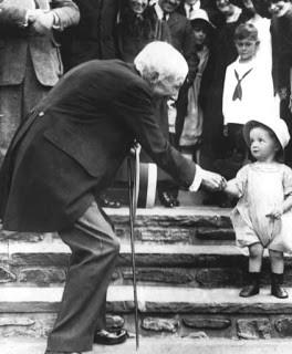 John D. Rockefeller hand out to a little girl