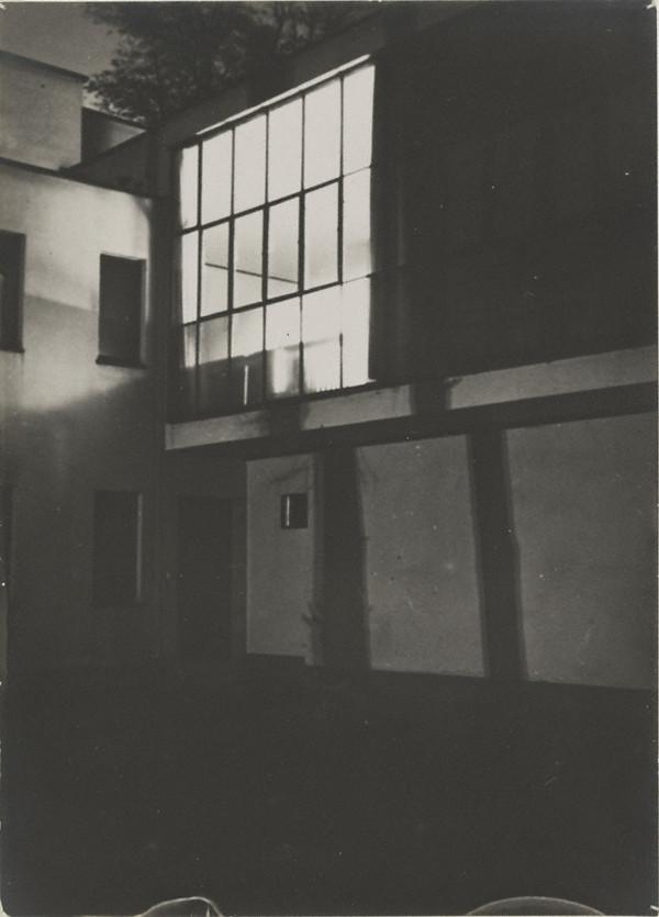"""Moholy's Studio Window"" around 10 p.m., 1928. Gelatin silver print, 7 x 5 1/16 in. Credit: Bauhaus-Archiv Berlin. © Artists Rights Society, New York / VG Bild-Kunst, Bonn."