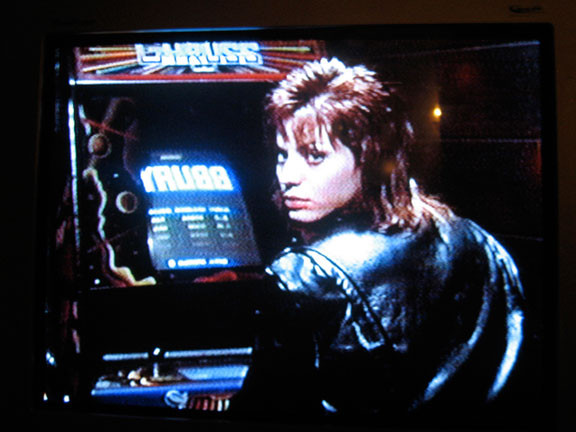 Joan Jett wearing leather playing video games