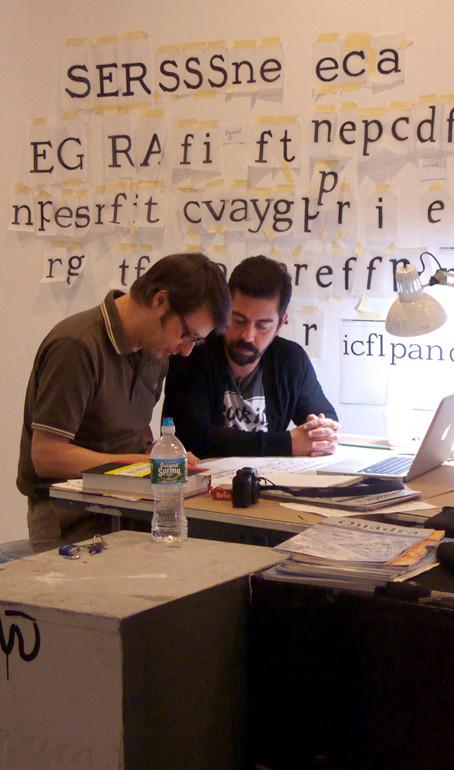Instructor Jean François Porchez (left) gives a hands-on demo to student Manuel Olmo