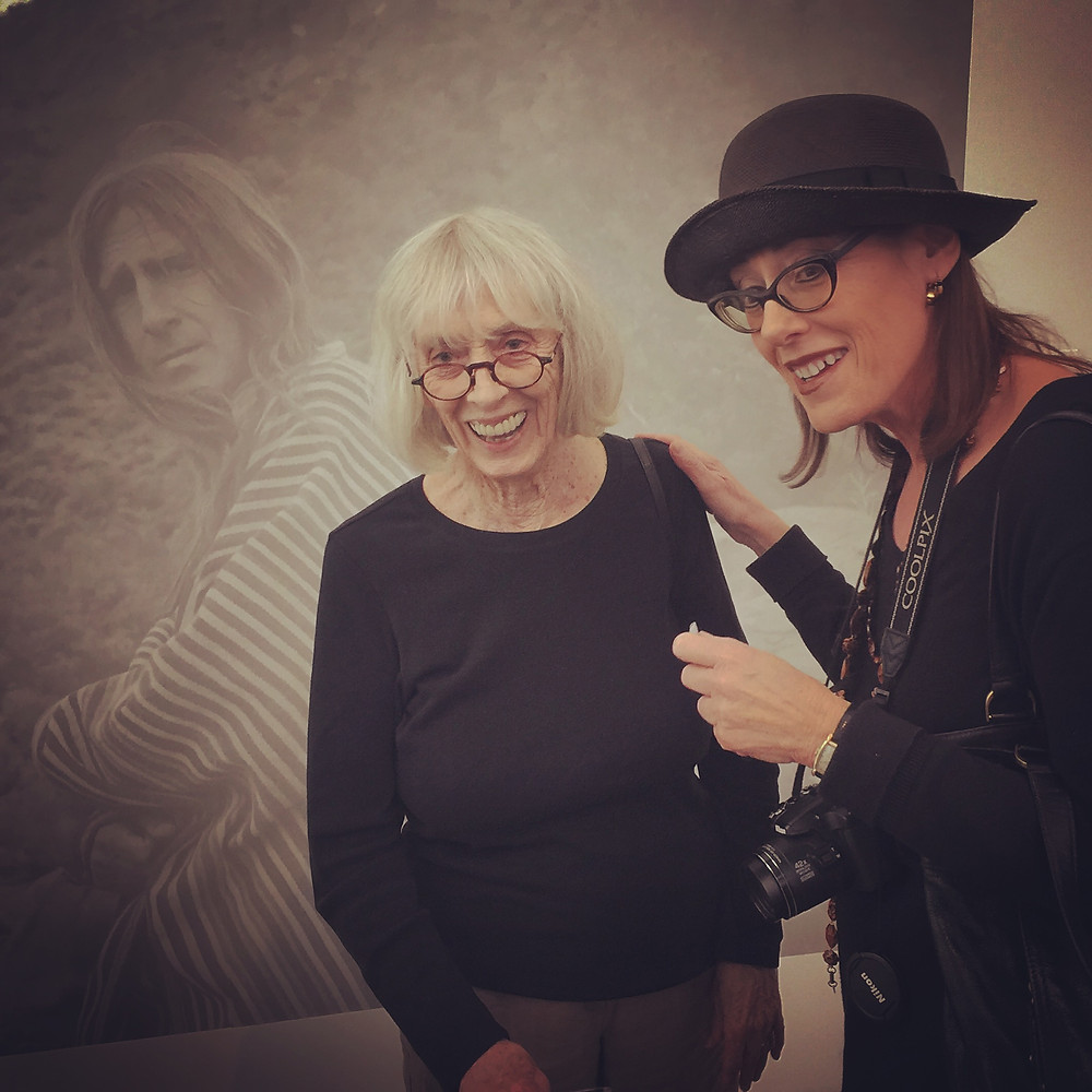 Shirley Berman with photographer Ellen Berman (no relation) next to a wall photo of her husband at the Kohn Gallery's entrance to Wallace Berman: American Aleph. photo: M Dooley.